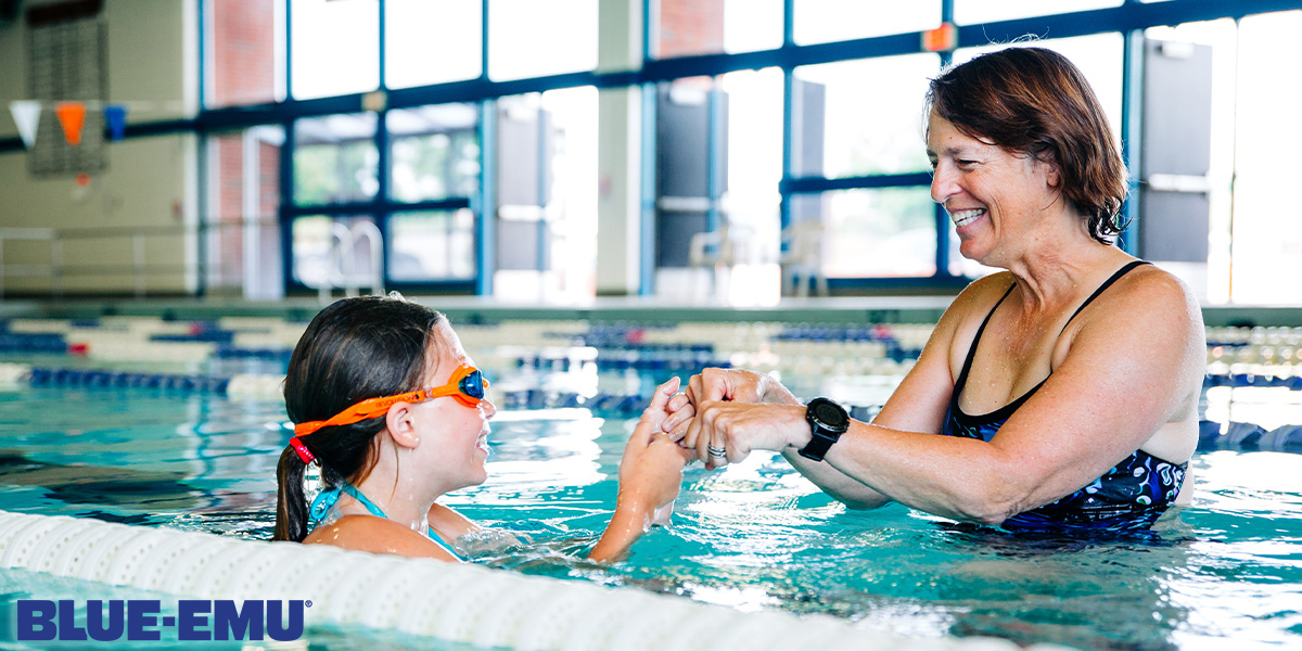 Image of Janine Pleasant teaching a girl better swimming techniques at a local pool