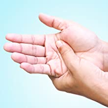 Image of hands rubbing the palm to relieve pain on a light blue background