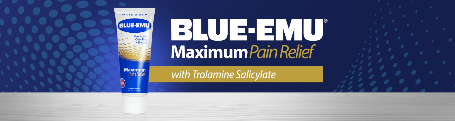 Image of Blue-Emu Maximum Pain Relief Cream tube on a grey wood surface with a blue dotted background and the words Blue-Emu Maximum Pain Relief with Trolamine Salicylate